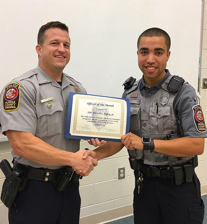 Lt. Ryan Morgan (left) presents the award to PFC Darrell Haley Jr.