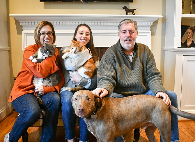Jane, Hannah, 23, and Bob Picardi sit with their family of pets: Cats Bernie, Nacho, and their dog Cooper.