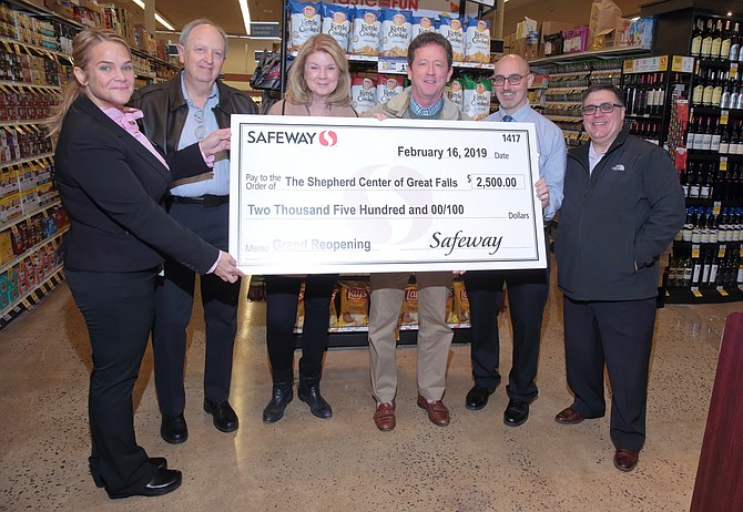 The Shepherd Center of Great Falls accepts a donation to their nonprofit organization from Safeway, during the store's remodeling celebration. Safeway also made a donation to Best Buddies Langley, a group from Langley High School that raises funds while raising awareness to support persons with intellectual and developmental disabilities.
