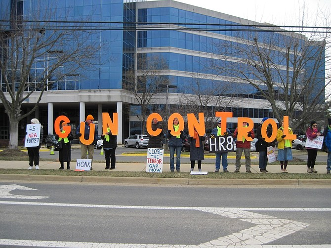 "While many folks hand out little boxes of candy sweethearts scribed with brief love notes in capital letters on Feb. 14, community activists of the Herndon-Reston Indivisible spell out ""gun control"" in large orange letters and all caps on Valentine's Day for the National Rifle Association at 11250 Waples Mill Road and the motorists who drive past."