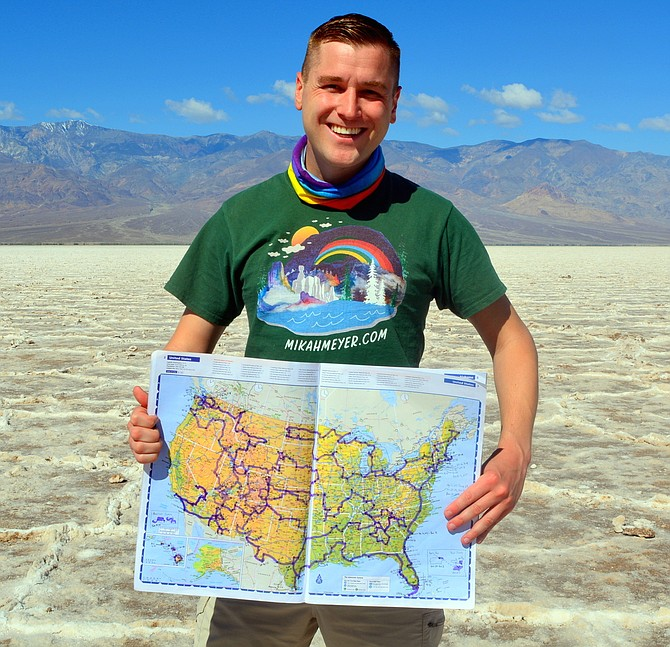 Former Bethesda resident Mikah Meyer is visiting all 418 U.S. National Parks and Historic Sites in one continuous trip. In Death Valley National Park, Calif., he shows a map charting progress of his trip.