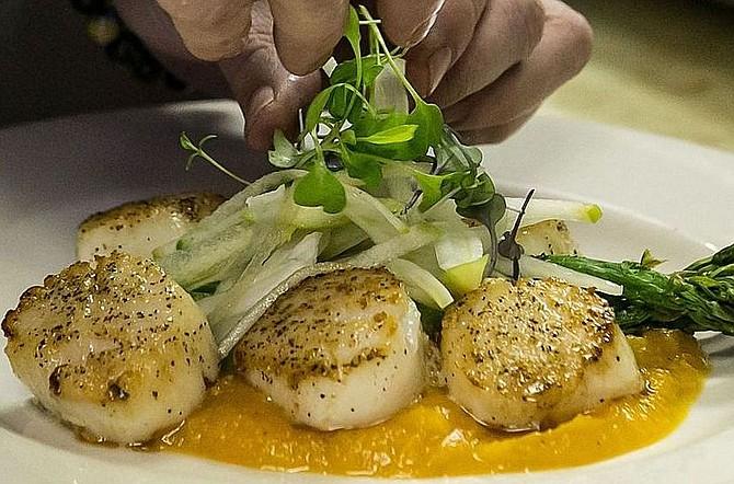 A dish of scallops at Dolce Vita.