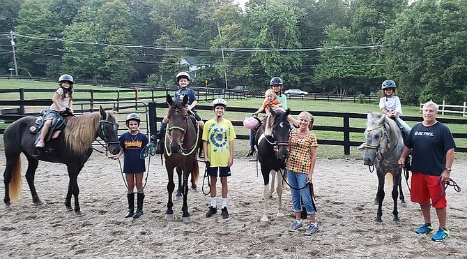 From left: Brooklyn on Cocoa, Christina, Hunter on Morgan, Christian, Gabriella and Henry on Ruger, Tina Maier, Allysa on Traveller, and Chris Maier at Live, Laugh, Relax Therapeutic Center in Fairfax Station.