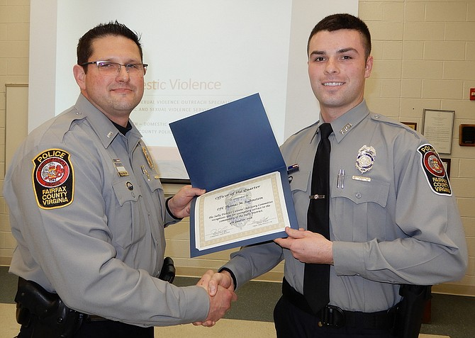 Assistant Station Commander, Lt. Todd Billeb (left), presents the Officer of the Quarter award to Officer Thomas Rubinstein.