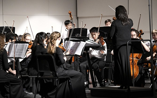 Elizabeth Leung conducting the Cooper Middle School Orchestra.