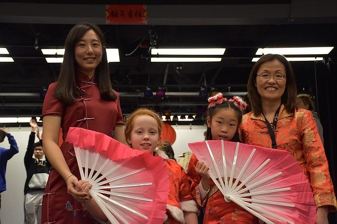 BIM Mandarin teachers, Ms. Hao Wang and Ms. Carrie Tozzi, with BIM students Rebecca Tanesi and Evelyn Zheng.