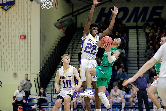 South Lakes' Brian Adams #1 is blocked by Lake Braddock's David Solomon #22.