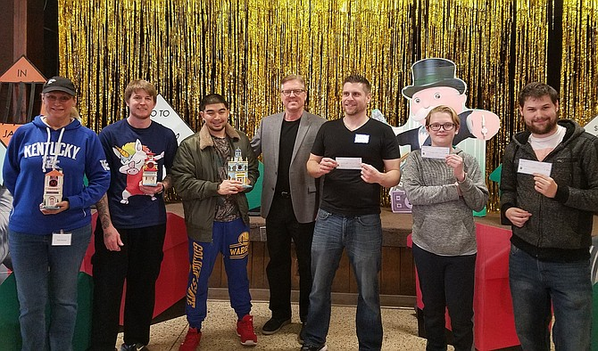 The Monopoly Tournament winners with Organizer Ron Kowalski (center). Winning first place (from left to right) was Bobby Driscoll, who won $500; second place went to Alex Kowalski, who won $250; third place went to David Adkins, who won $100; fourth place went to Melson Varsovia; fifth place went to Carl Klein; and sixth place went to Robin Nicholas.