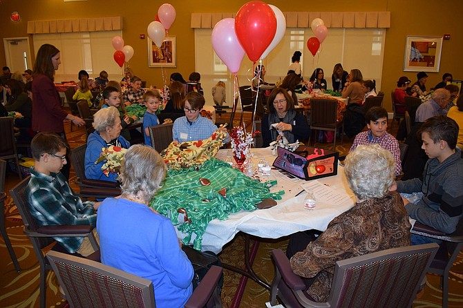 An Intergenerational event with the Potomac School brought students and seniors together at Vinson Hall to assemble Valentine's Day care packages that were delivered to wounded warriors at area hospitals.