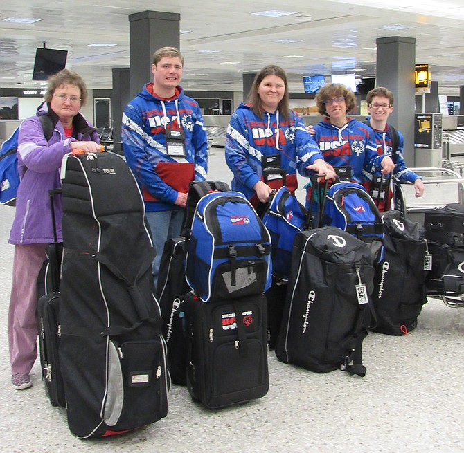 "From left, Special Olympics Athletes Grace Anne Braxton of Fredericksburg, Dylan Joseph ""Joey"" Roney of Herndon, Jenny Mitchell of Alexandria, Karen Dickerson of Springfield and Victoria ""Tori"" Martin of Woodbridge prepare to depart Dulles International Airport to head to the Special Olympics World Games Abu Dhabi 2019."