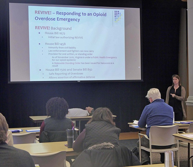 Emily Siqveland offers REVIVE! Opioid Overdose and Naloxone Education training to community attendees.