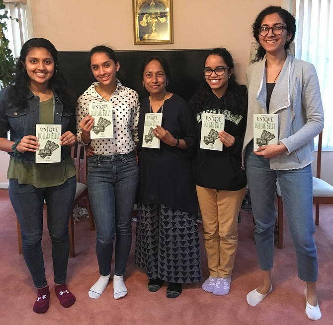 "Author Chitra Krishnamurti, also known as Sea Kay, center, is surrounded by some of the young women who helped illustrate and edit her book ""Unique Dollar Billy."" Sea Kay held a book launch part at her Potomac home Sunday, March 10."