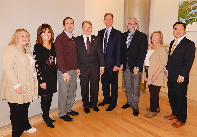 At Rob Stalzer's welcoming reception from Fairfax City were (from left) Council members Jennifer Passey, So Lim and Jon Stehle; Mayor David Meyer; Stalzer; and Council members Michael DeMarco, Janice Miller and Sang Yi.