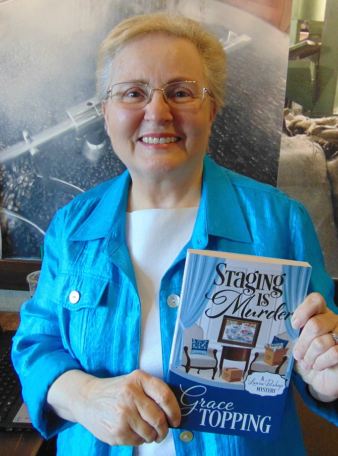 "Author Grace Topping of Fairfax Station with her book, ""Staging is Murder."""