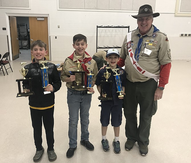 "2019 Overall Pinewood Derby Winners (from left): Third Place Overall Finisher - Ben M., Pack 1860; Second Place Overall Finisher Zaid K., Pack 127, and First Place Overall Finisher - Hadrian A., Pack 146, with 2019 Sully District Pinewood Derby Chairman R ""Hondo"" Davids."