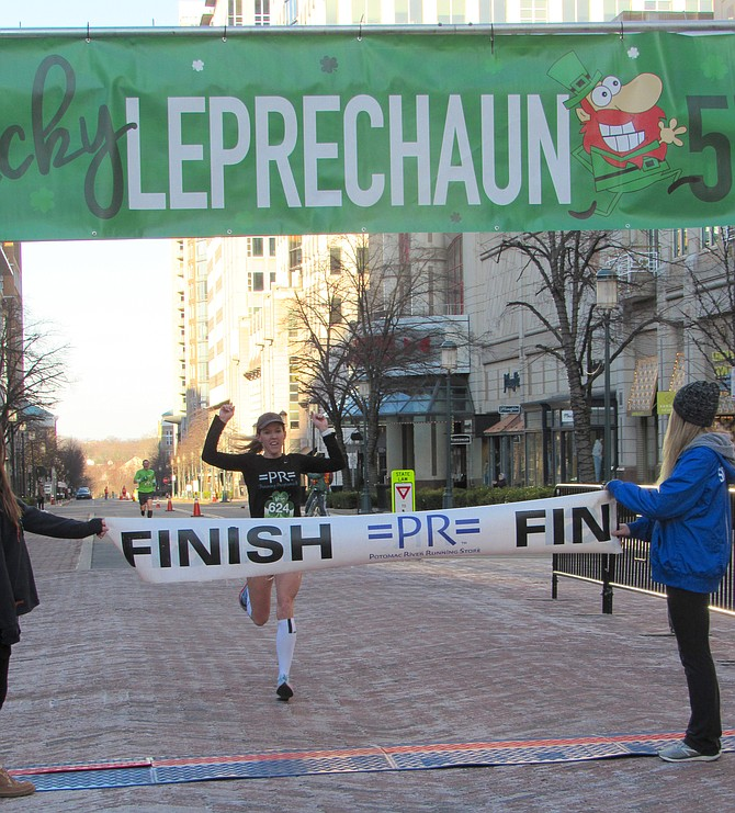 Oakton High School grad and current Midlothian, Va., resident, Keira D'Amato places first overall in the 2019 Lucky Leprechaun 5K Race produced by Potomac River Running and held at Reston Town Center on Sunday, March 17.