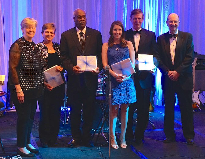 Senior Services of Alexandria executive director Mary Lee Anderson, left, and board chair Jack Fannon, right, are joined onstage by honorees Jen Walker, Lynnwood Campbell, Stephanie Beyer Kirby and U.S. Rep. Don Beyer (D-8) at the Senior Services of Alexandria Gala March 16 at the Westin Alexandria.