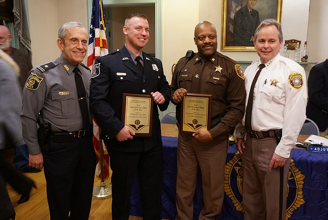 Alexandria Police Officer Sean Gallagher and Alexandria Sheriff's Office Master Deputy Jeffrey Hunter, center, with Police Chief Michael Brown and Undersheriff Tim Gleeson following the presentation of the Law Enforcement Officer of the Year awards March 13 at the American Legion Post 24 in Old Town.