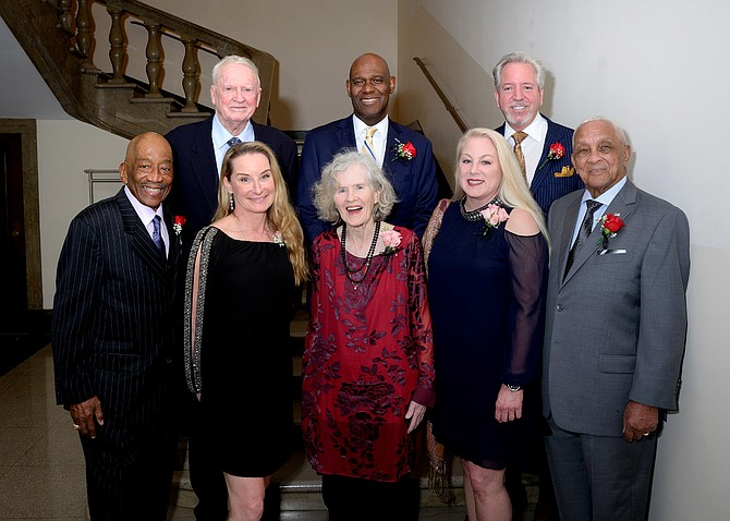 "The 2019 Living Legends of Alexandria pose for a photo prior to the start of the Meet the Legends reception March 14 at the George Washington Masonic National Memorial. Shown in front: James Henson, Brooke Sydnor Curran, Jane King, Loren Yates, and Lawrence ""Robbie"" Robinson. In back: Capt. Eugene ""Red"" McDaniel, Ronal Butler, and Jason Yates."