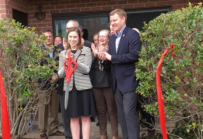Alexis Feeney Tallman, chairwoman of Good Shepherd Housing and Family Services Board, and Jeff McKay, Lee District supervisor at March 14 ribbon-cutting.