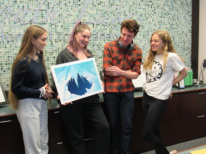 "From left, South Lakes High School's Regional Scholastic Art Awards recipients: Katia Pavlova, 16, Silver Key; Laela Huddleston, 17, Gold Key; James Bailey, 18, Gold Key; and Selin Boybeyi, 18, Gold and Silver Key; winners give their feedback on  ""Cold Hell,"" by student artist Huddleston during a break from art class."