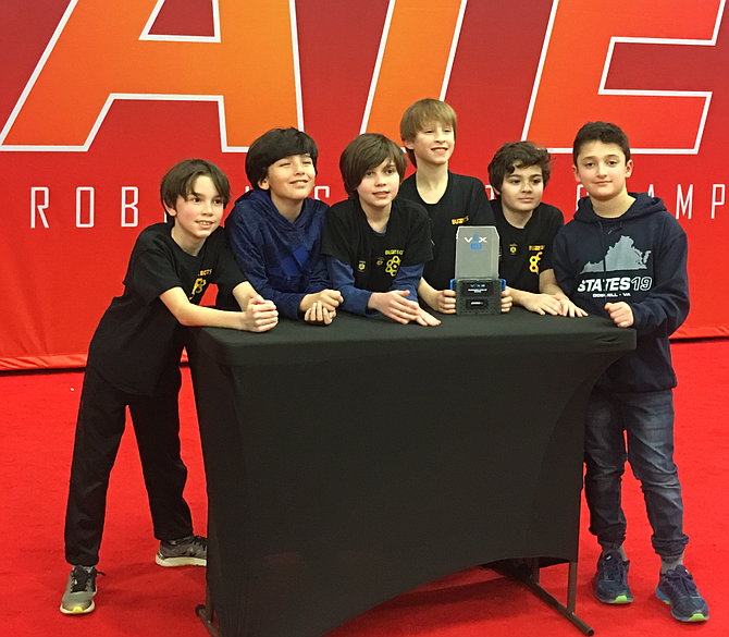 Drew Hull, 9, Youssef Bousaidi, 10, Liam Hull, 11, Matthew Mudry, 10, Daniel Murphy, 10,  and Alexander Abboud, 11, all students at Aldrin Elementary School in Reston were awarded the Second Place Robot Skills Award which they received at the VEX Robotics State Championship for the state of Virginia held in Doswell.