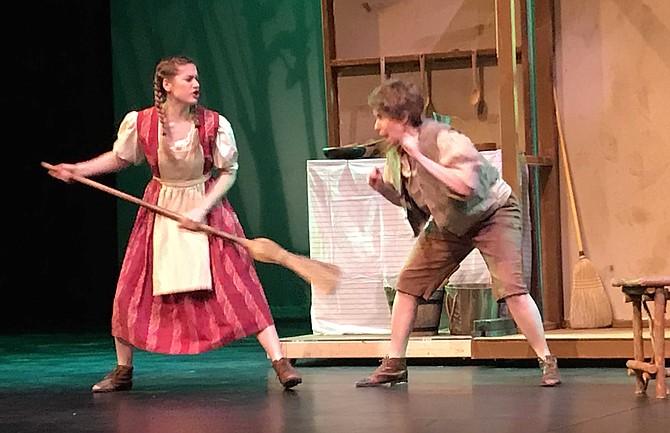 Kristi Spicer as Gretel chases Jennifer Matthews as Hansel.