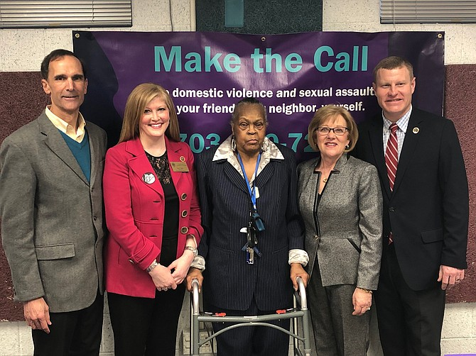 'The Three Musketeers' who led the effort to get a new shelter for victims of domestic violence: Lisa Sales, Mattie Palmore and Karen Stone, with Supervisors Dan Storck (left) and Jeff McKay (right).