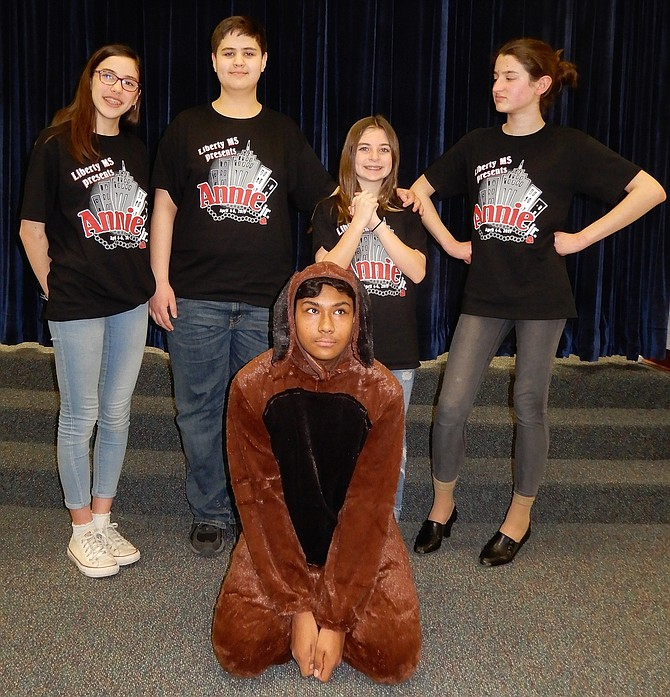 "Starring in Liberty Middle's production of ""Annie Jr."" are (standing, from left) Beth Buono, Noah Martineau, Caitlyn Barnes and Maddie LeBerre, with Samin Haque as Sandy the dog."