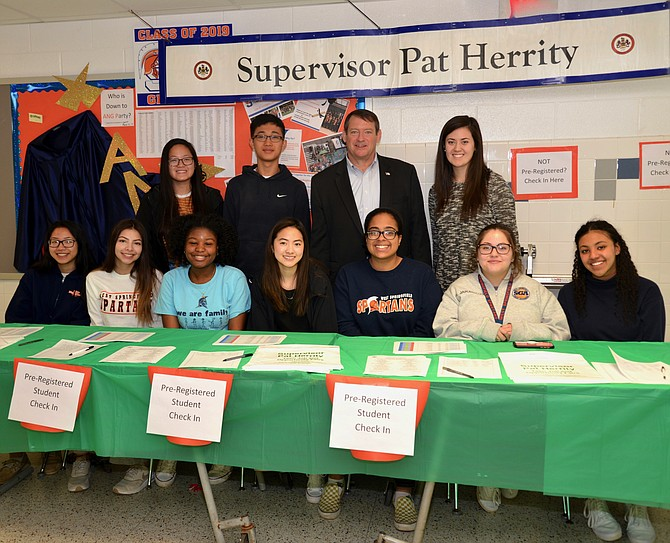 Here to help! Springfield Supervisor Pat Herrity, co-founder of the Teen Job Fairs and still its dedicated sponsor since 2015, and his army of volunteers at the ready to help young jobseekers sign in and get going.