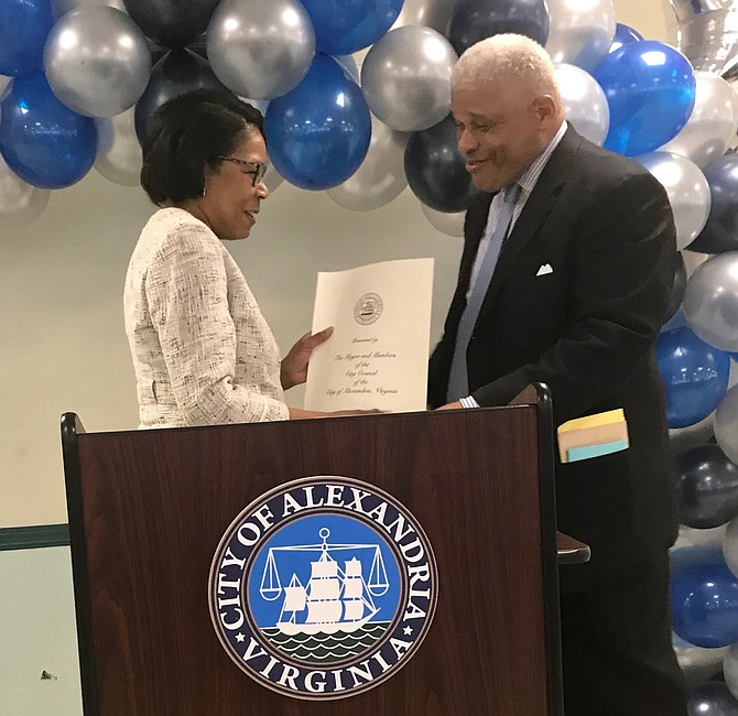 Deputy City Manager Debra Collins presents a proclamation to William Chesley, deputy director of Recreation Services, on the occasion of his retirement after 38 years of public service at a reception March 22 at the Nannie J. Lee Center.