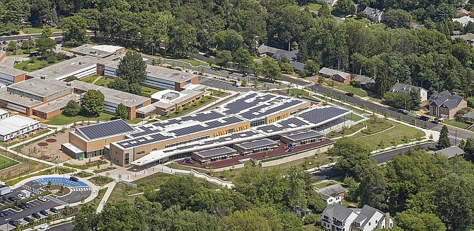 Some Fairfax County schools may soon sprout solar panels on their rooftops, like Discovery Elementary School in neighboring Arlington.