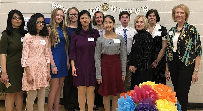 Attendees at the AAUW Mclean Area Branch Annual Dinner recognizing the winners of the STEM Essay Contest included, from left, Anita Banerjee, Anisha Talreja (Honorable Mention), Samantha Taylormoore (Honorable Mention), Melissa Taylormoore, Xin Li, Heather Walcott, Isabella Cai (1st Place), Peyton Walcott (2nd Place), Myrtle Hendricks-Corrales (Branch Co-President), Betsy Schroeder (Branch Co-President), and Judy Page (Branch STEM Chair).