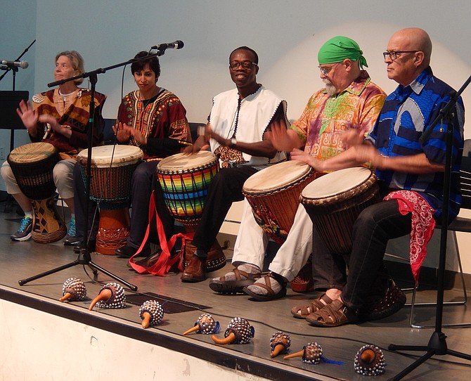 Kofi Dennis and Friends illustrate traditional African rhythms.