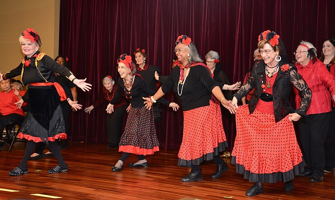 """Hey, Macarena!"" The ""Motion is Lotion"" Dance Troupe opens the Vinson Hall Talent Show – part of the 50th anniversary of the retirement community. Led by resident Midge Holmes, the dancers kicked things off with flair and had audience members dancing in the aisles."