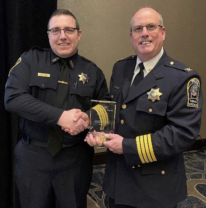 Pictured, from left: Master Police Officer Patrick Shaw and Chief James A. Morris.