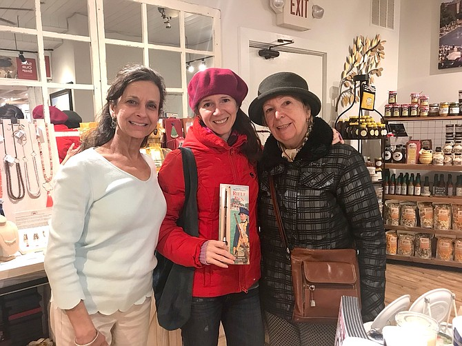 The Old Town Shop owner Valerie Ianieri, left, poses for a photo with Romanian tourists Lulia and Anca Teodoru March 31 during the shop's second anniversary celebration.