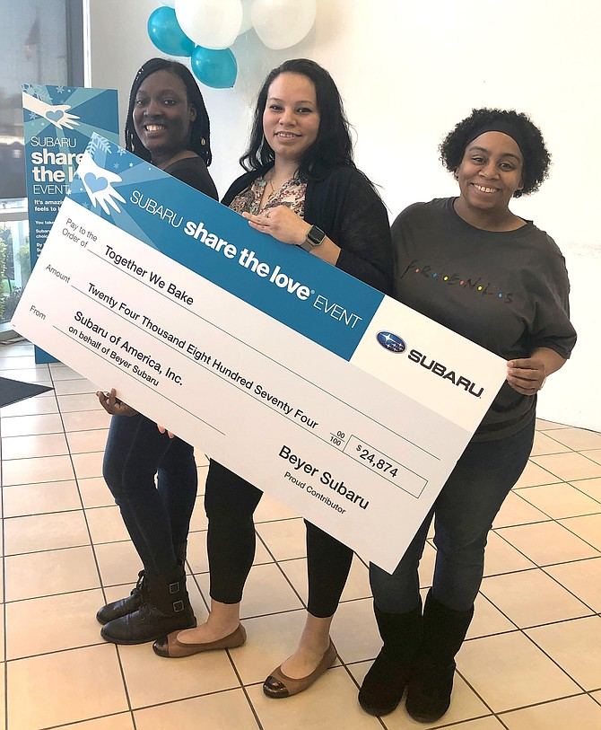 Teresa Ross, Lisbeth Delcid and Colida Johnson celebrate the donation of more than $24,000 to Together We Bake from Alexandria's Beyer Subaru. The trio are graduates of the nonprofit's job training program and are now employees of the organization.