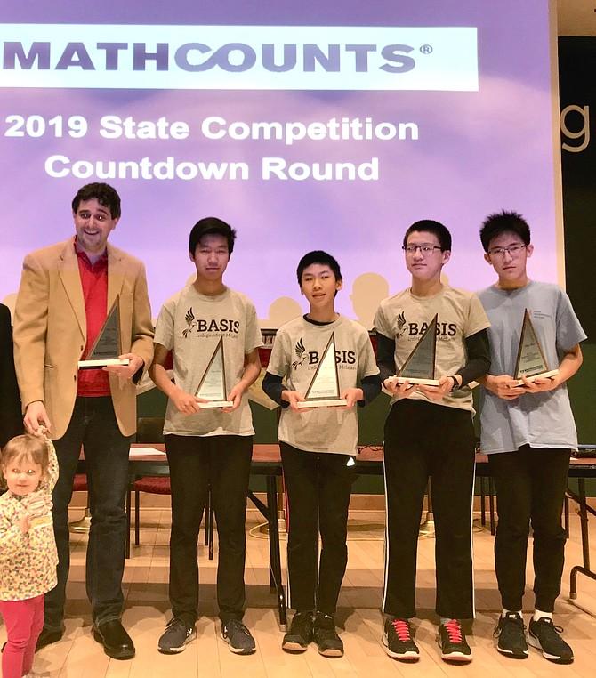 BIM Mathcounts Coach Tyler Sullivan and his daughter with BIM students: Sam Wang, Brian Lai, Max Yang, Ethan Zhou.