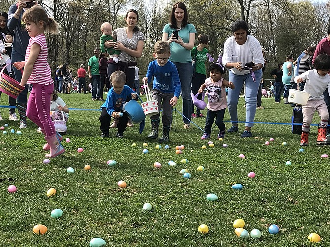 Children bolt to gather up the candy-filled plastic eggs at the 2019 Eggnormous Egg Hunt.