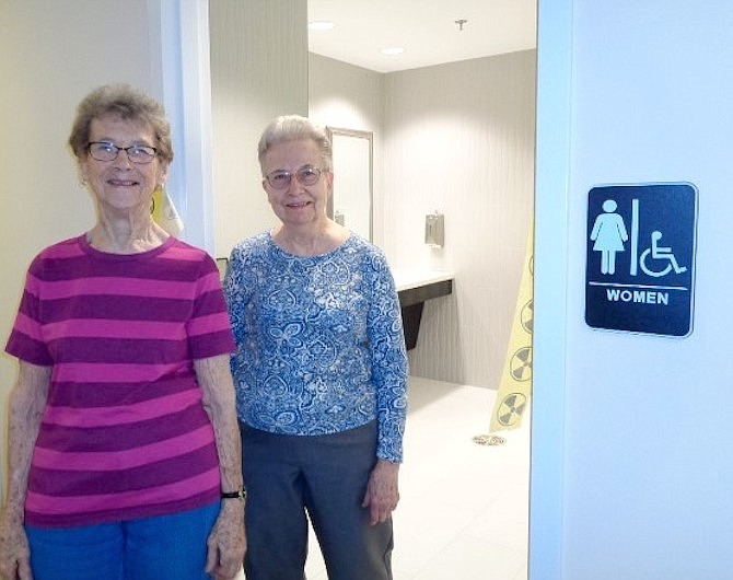 Culpepper Garden staff member Candy Dragity and resident Janice Nichols take the tour of the newly renovated restrooms at Culpepper Garden on April 12.