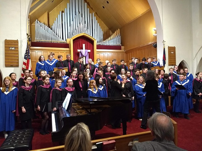 The Maitrise de Reims, choristers dressed in black, sang with the Clarendon United Methodist Church choir, dressed in blue.