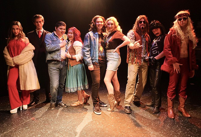 "Rehearsing a scene from ""Rock of Ages"" are (from left) Lauren LeVine, Braeden Anderson, Alan Gutierrez-Urista, Faith Cho, John Henry Stamper, Keeley Rogers, Harry Schlatter, Josh Moore and Colin Brown."