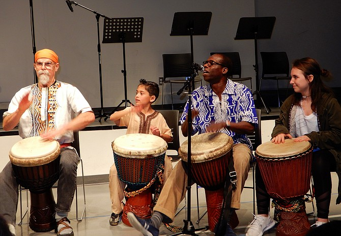 Kofi Dennis (second from right) and Friends wow the crowd with their drumming.