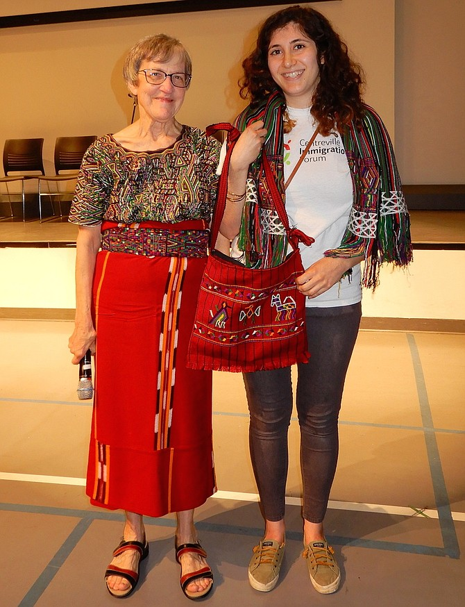 From left, are Centreville Immigration Forum President Alice Foltz with outgoing Centreville Labor Resource Center Manager Samantha Zaboli. During the CIF's annual Centreville International Showcase, Saturday night, April 13, Foltz presented Zaboli with a shawl and bag handmade in Guatemala. Many of the day laborers at the CLRC come from Guatemala and, for the past two years, Zaboli has managed that center. But she's now leaving that job to spend more time with her husband and child, so these were gifts to show appreciation for all she's done.