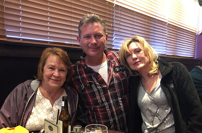 Jim Fowler, with his wife Patty, right, and mother-in-law Eileen Samuels, celebrates his retirement from the Alexandria Police Department April 1 at Fiona's Irish Pub in Kingstowne. Fowler served 25 years on the force, the last 12 on the motorcycle squad.