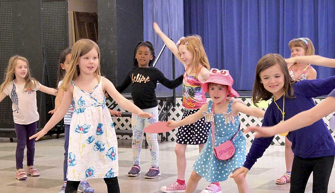 K-2 grade children perform at spring break camp.