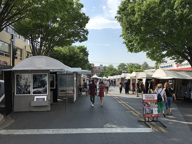 Festive tents along the street invite visitors into Bethesda Fine Arts Festival.