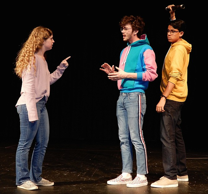 "A confrontation during Centreville High's upcoming play, ""Clue."" (From left) are Savannah Lagana (Mrs. Peacock), Ben Stallard (Mr. Boddy) and Michael Crevoisier (Mr. Green)."