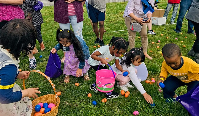 Children collect eggs at The Biggest Easter Egg Hunt April 20 at Mount Vernon High School. The family event was sponsored by Washington Community Church and featured more than 20,000 candy-filled eggs.